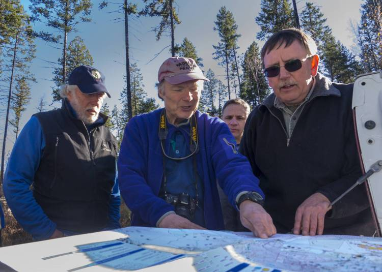 Wildsight's John Bergenske and Juri Peepre, as well as Paul Frasca, RPF, go over a cut block map with Ken Streloff, RFT on a Forestry Field Trip with Canfor to Horsethief drainage.